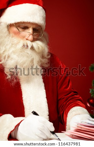 Portrait of Santa Claus answering Christmas letter