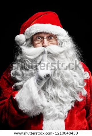 Portrait of santa claus gesturing at studio shot  #1210048450