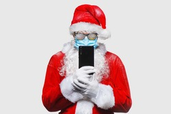Portrait of Santa Claus in respiratory protection mask stands on