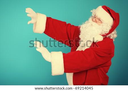 Portrait of Santa Claus over blue background. Christmas.
