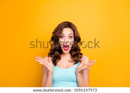 Portrait of scared mad girl yelling with wide open mouth isolated on yellow background. Sale discounts advertisement concept