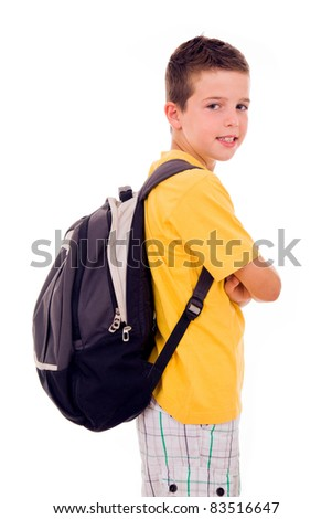 Portrait of school boy standing with scholl bag, isolated on white