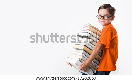 Portrait of schoolboy wearing glasses and holding books in hands - stock photo