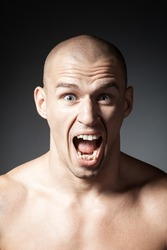 portrait of screaming man isolated on gray background
