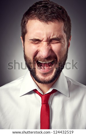 portrait of screaming man over grey background