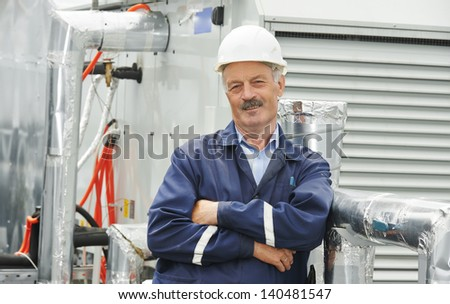 Portrait of senior adult smiling ventilaation electrician builder engineer