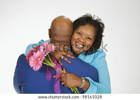 Portrait of senior African couple hugging