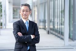 portrait of senior asian businessman standing