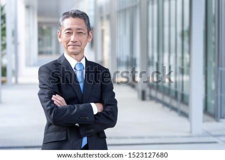 portrait of senior asian businessman standing  Foto stock ©