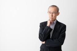 portrait of senior asian man thinking on white background