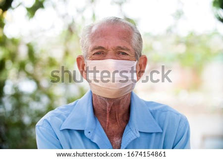 portrait of senior brazilian man using medicine healthcare mask for health medical care, protect Covid-19 and Air pollution pm2.5