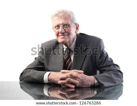 portrait of senior business man sitting at his desk