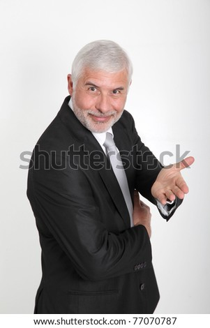 Portrait of senior businessman showing thumbs up