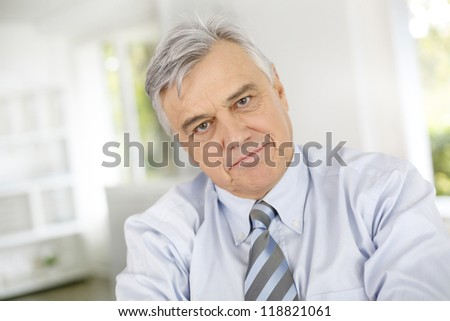 Portrait of senior businessman with serious look