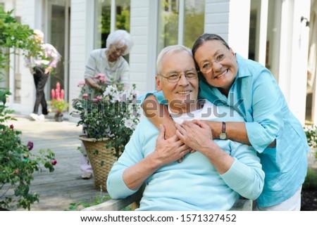 Portrait of senior couple outdoors at Seniors' Living Community