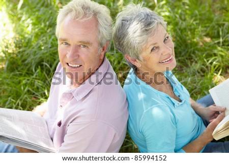 Portrait of senior couple reading