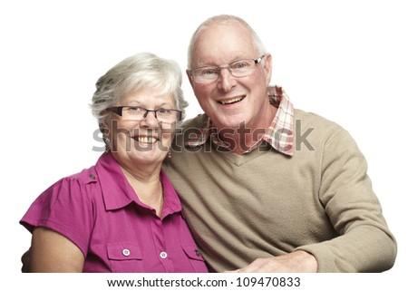 Portrait of senior couple smiling on white background