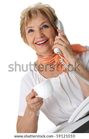 Portrait of senior female with cup of tea calling somebody on the phone