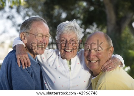Portrait of senior friends smiling. Horizontally framed shot.