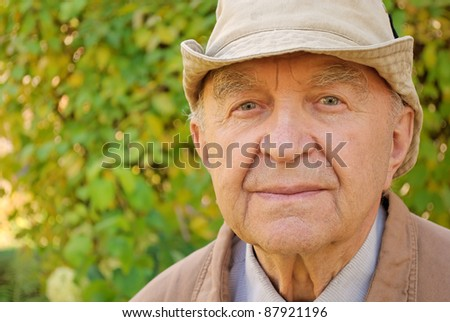 portrait of senior man in his garden