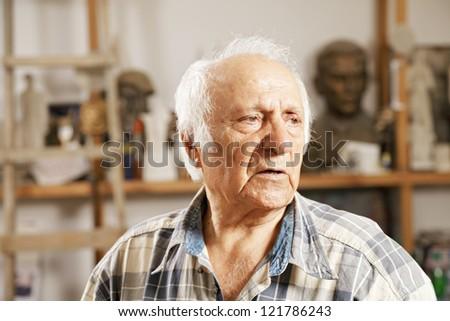 Portrait of senior man in sculptor workshop #121786243