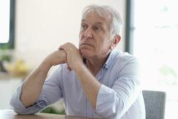 Portrait of senior man showing sadness