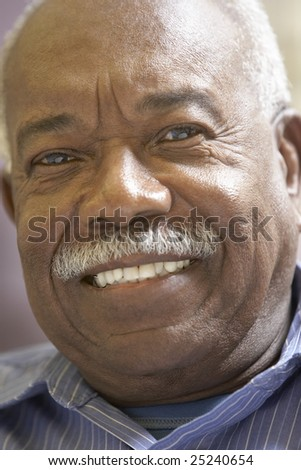 Portrait Of Senior Man Smiling At The Camera