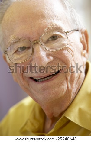 Portrait Of Senior Man Smiling Happily