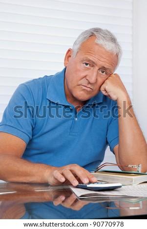 Portrait of senior man upset with financial budget - stock photo