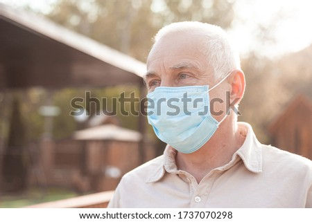 Portrait of senior man wearing medical mask. coronavirus concept. respiratory protection