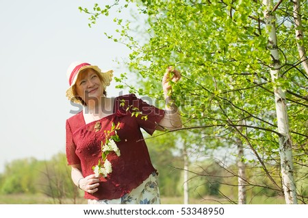 portrait of senior woman against spring  landscape