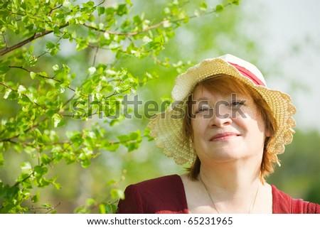 portrait of senior woman against spring  landscape