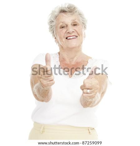 portrait of senior woman gesturing good over white background