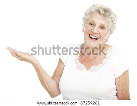 portrait of senior woman gesturing offer with hand over white background