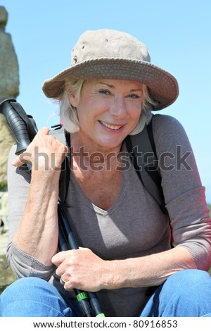 Portrait of senior woman in hiking outfit