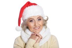 Portrait of senior woman in Santa hat isolated