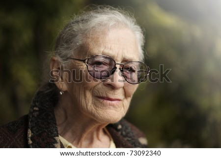 Portrait of senior woman outdoors. Closeup.