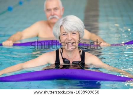 portrait of senior woman with friends #1038909850