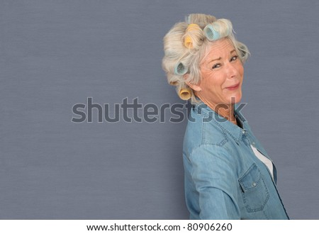 Portrait of senior woman with hair curlers