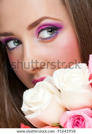 Portrait of sensual beautiful woman with roses and stylish bright make-up
