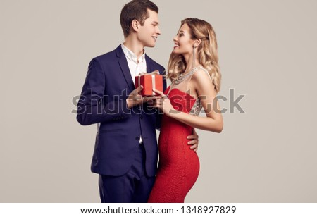 28b27d86242b Portrait of sensual beautiful young couple dressed in formal clothes: man  wearing blue classical suit