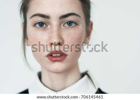portrait of sensual beautiful young girl with freckles close-up