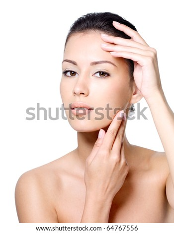 Portrait of sensual beautiful young woman stroking her face - white background