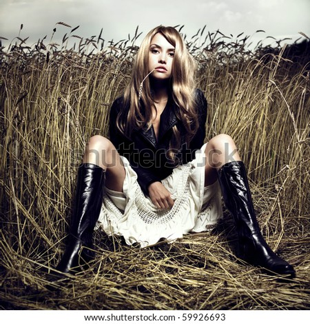 Portrait of sensual blond girl in wheat