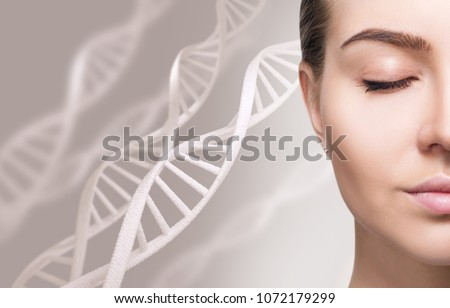 Portrait of sensual woman among white DNA chains.