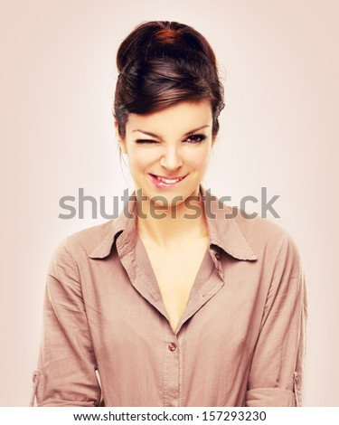 Portrait of sensual young woman biting her lips.