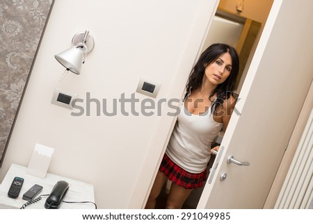 Portrait of sensual young woman in hotel room.