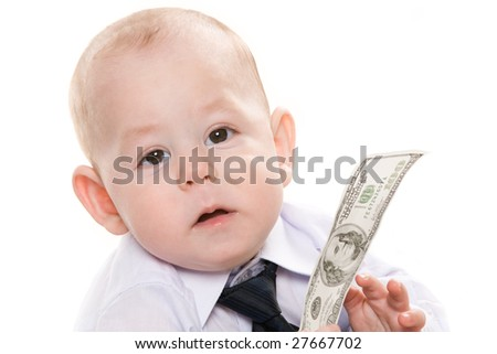 Portrait of serious baby boy with dollar banknote looking at camera