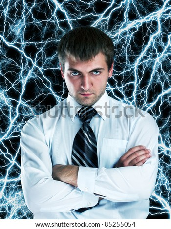 Portrait of serious businessman against lightnings background