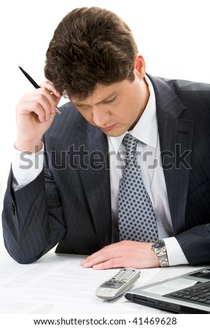 Portrait of serious businessman looking at plan while thinking about project